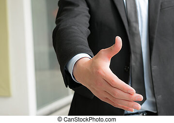 Business people shake hand to deal with you, blurred background
