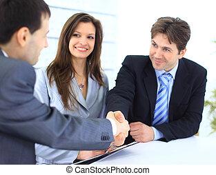 Business people shaking - Business people shaking hands,...