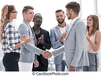 Business people shaking hands a meeting