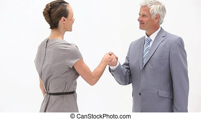Business people shaking hands again