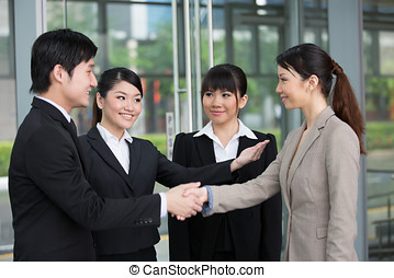 Business people shaking hands. - Asian Business man and...