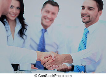 Business people shaking hands at a meeting
