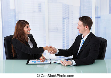 Business People Shaking Hands At Office Desk - Happy young...