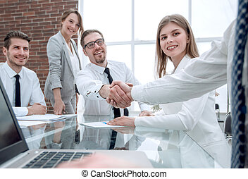 business people shaking hands at the office table.