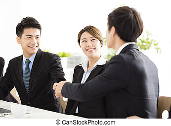 business people shaking hands during meeting