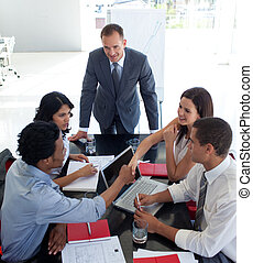 Business people shaking hands in a meeting