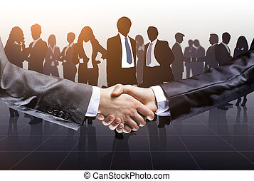 business people shaking hands to confirm their partnership