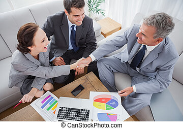 Business people shaking hands while working