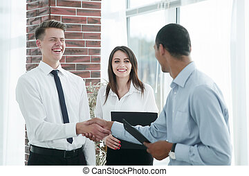 business people shaking hands with each other in the office.
