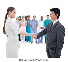 Business people shaking hands with