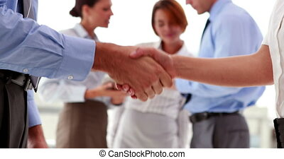 Business people shaking their hands in the office