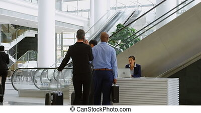Business people showing mobile phone at reception 4k