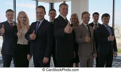 Business people showing thumb up