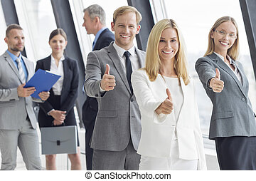 Business people showing thumbs up