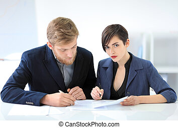 Business people signing a contract