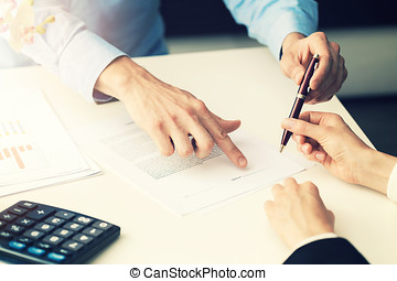 business people signing partnership contract at office