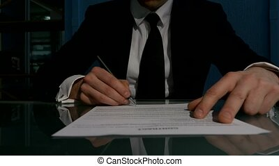 Business people signing the contract to conclude a deal