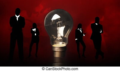 Business people silhouettes and a lightbulb. Concept of clever