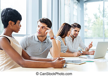 Business people sitting and talking in office