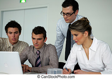 Business people sitting at a laptop