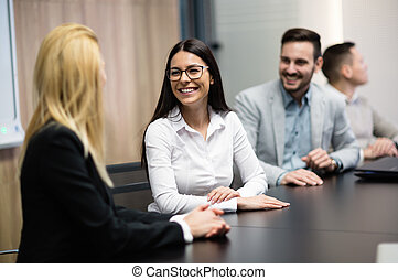Business people sitting at table