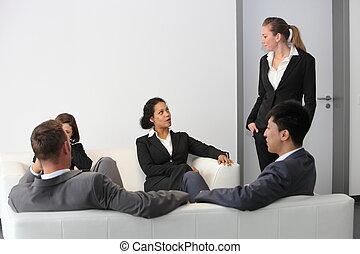 Business people sitting in a waiting room
