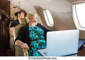 Business People Sleeping On Plane