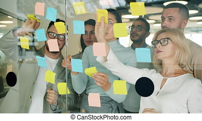 Business people solving business problems in office using ...
