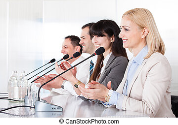 Business People Speaking In Microphone