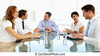 Business people speaking together during meeting in the...