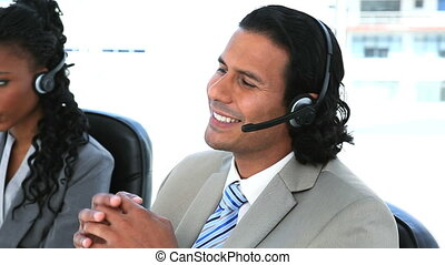 Business people speaking while wearing headset