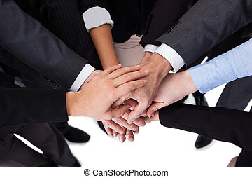 Business people stacking hands - High angle close-up shot of...