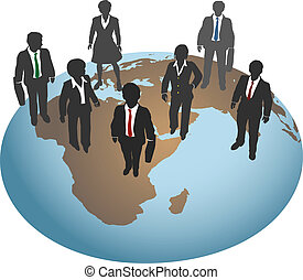 Business people stand on global world