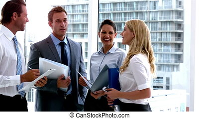Business people standing and talking in slow motion