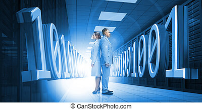 Business people standing back to back with 3d binary code in blue in hall of data center