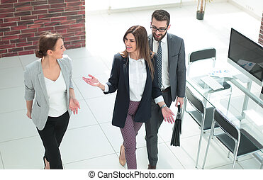 business people standing in a modern office