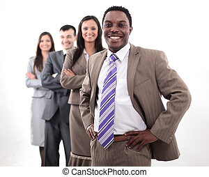 Business people standing in a row looking at camera