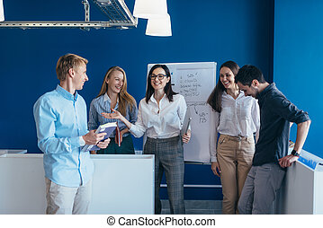 Business people standing together in a office.