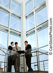 Business people - Image of business people interacting on...