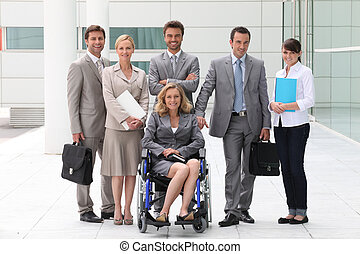 Business people stood outside building