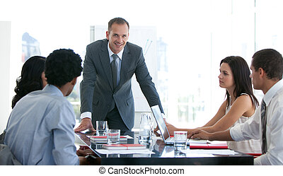 Business people studying a new plan in a meeting - Business ...