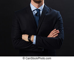 businessman in suit and smartwatch