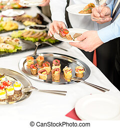 Business people take buffet appetizers