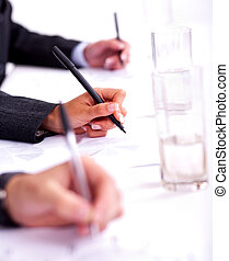 Business people taking notes in the business conference