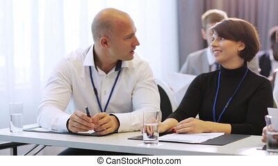 business people talking at conference