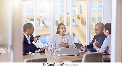 business people talking during meeting in modern offices -...