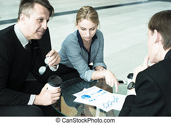 Business people talking in cafe