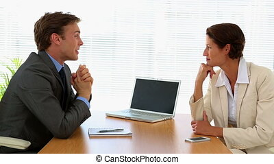 Business people talking together at a desk