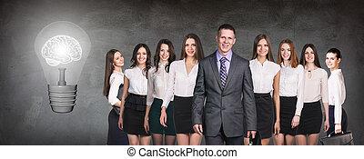 Business people team near big bulb