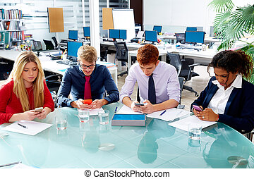 Business people team playing smartphones
